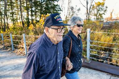 Senior couple linking arms and walking