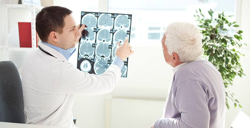 Doctor holding up memory impairment test