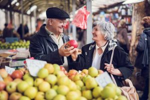 Two seniors shopping for produce together