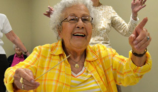 A Grace Ridge resident smiles and participates in an activity