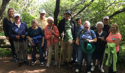 a group of residents go hiking together